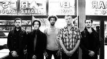 Queens of the Stone Age frontman Josh Homme, second from right, suffered from depression after a near-death experience in 2010. (Nora Lezano)
