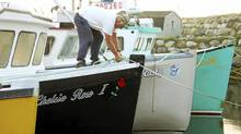Darrel Nickerson secures a line to his fishing boat Chelsie Rose in Clark's Harbour, Nova Scotia, September 3, 2010. Fishing fleets along coastal communities are taking precautions as Hurricane Earl moves closer to the province. (REUTERS/Paul Darrow/REUTERS/Paul Darrow)