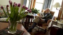 Modris Eksteins reading in his armchair in his Toronto home on March 7, 2012. (Peter Power/The Globe and Mail)