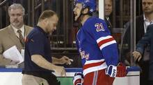 New York Rangers Derek Stepan (21) leaves the ice with a member of the Rangers staff after taking a hit from Montreal Canadiens forward Brandon Prust during Game 3 of the NHL Eastern Conference finals in New York on May 22, 2014. (Kathy Willens/AP)