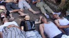 Bodies of people activists say were killed by nerve gas in the Damascus suburb of Zamalka on Aug. 21, 2013. (Hadi Almonajed/Reuters)