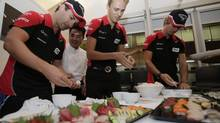 Marussia team driver's (L) Timo Glock, of Germany and Max Chilton of Britain (Shizuo Kambayashi/The Associated Press)