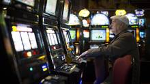 A customer at a slot machine at the River Rock Casino in Richmond, February 22, 2013. (John Lehmann/The Globe and Mail)