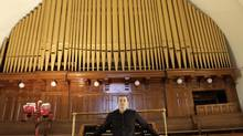 Jesse Speigel, co-ordinator of the project going up in the former church, remains saddled with the Casavant Opus organ. (Fernando Morales/The Globe and Mail)
