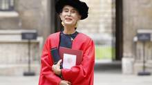 Aung San Suu Kyi poses for a photograph after receiving her honorary degree at Oxford University on June 20, 2012. (ANDREW WINNING/Andrew Winning/Reuters)