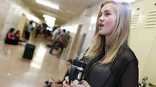 Alanna Aucoin, 17, is a Grade 12 student at Etobicoke School for the Arts, where students are now bringing their own coffee and tea to cope with a provincewide ban on caffeinated products in schools. (Peter Power/The Globe and Mail)