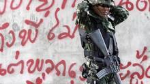 Dark shadow over the Thai smile (DAMIR SAGOLJ/Reuters)