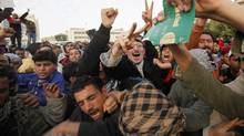 Protesters tear a copy of the Green Book as they chant antigovernment slogans in the main square in Tobruk on Feb. 22, 2011. (ASMAA WAGUIH/Asmaa Waguih/Reuters)