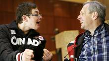 Gold medal winner Alex Bilodeau's brother, Frederic, and father, Serge, share a laugh during an interview with the Globe and Mail. (Charla Jones/Charla Jones/THE GLOBE AND MAIL)