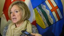 Alberta Premier Rachel Notley speaks to reporters in Calgary on Oct. 4, 2016. (Jeff McIntosh/THE CANADIAN PRESS)