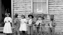 First Nations children hold letters spelling out 'goodbye' at Fort Simpson Indian Residential School in 1922. (J.F. MORAN/LIBRARY AND ARCHIVES CANADA)