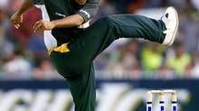 Pakistani fast bowler Shoaib Akhtar, frustrated at missing a wicket, kicks the ground at the end of an over. (WILL BURGESS/REUTERS)