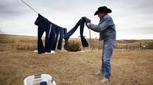 County music legend Ian Tyson hangs his wrangler jeans out to dry on his ranch near Longview, Alberta, March 11, 2008. (Todd Korol for The Globe and Mail)