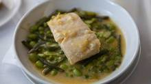 Fillet of pollock over vivid favas and French beans, in a buttery sauce made with mussel broth and lemon. (Chris Nuttall-Smith/The Globe and Mail)