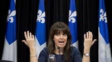 Quebec Minister for Social Services and Youth Protection Véronique Hivon explains legislation on the right to die in dignity at a news conference in Quebec City on Wednesday, June 12, 2013 (Jacques Boissinot/THE CANADIAN PRESS)