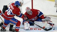 Montreal Canadiens goalie Carey Price (31) stops Anaheim Ducks left wing Daniel Winnik (34) as Montreal Canadiens defenseman P.K. Subban (76) moves in during first period National Hockey League action Thursday, October 24, 2013 in Montreal. (RYAN REMIORZ/THE CANADIAN PRESS)