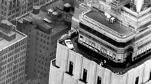 A 1966 convertible perched on a corner of the 86th floor parapet of the Empire State Building. The car was later moved inside the building to the observation deck. (Ford)