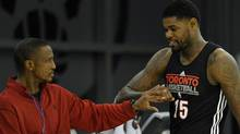 Toronto Raptors Amir Johnson greets head coach Dwane Casey (L) during the team's first practice of their NBA basketball season in Toronto December 9, 2011. REUTERS/Mike Cassese (Mike Cassese/Reuters)