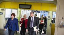 New TransLink CEO Kevin Desmond, right, leaves a news conference after the announcement of his appointment. He is seen alongside acting CEO Cathy McLay, middle, Surrey mayor Linda Hepner, left, and Vancouver mayor Gregor Robertson, second from right, at Waterfront Station in Vancouver. (Rafal Gerszak/Rafal Gerszak)