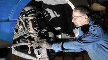 Mechanic John Grace, 61, works on a police vehicle at the Halton region garage in Georgetown, Dec. 4, 2012. (J.P. MOCZULSKI FOR THE GLOBE AND MAIL)