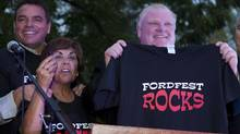 Mayor Rob Ford holds up a Ford Fest T-shirt on Sept. 2, 2011, at his mother's house in Etobicoke. Coucillors Giorgio Mammolitti and Frances Nunziata are to his left. (MATTHEW SHERWOOD FOR THE GLOBE AND MAIL)