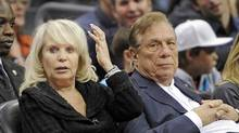 In this Nov. 12, 2010, file photo, Los Angeles Clippers owner Donald Sterling and his wife Shelly are shown during a basketball game between the Detroit Pistons and the Clippers in Los Angeles. (Mark Terrill/AP)