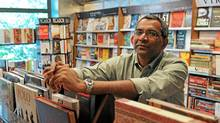 David Davidar, author and publisher, photographed at The Book Shop his father-in-law's book store in New Delhi. (Candace Feit for The Globe and Mail)