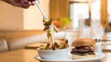 Fable Diner attempts to elevate the classic greasy spoon, serving burgers made from hand-minced, grass-fed ground beef in an authentically retro atmosphere. (Ben Nelms/The Globe and Mail)