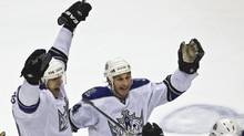 Los Angeles Kings' Michal Handzus (L) and Ryan Smyth celebrate a goal scored by team mate Anze Kopitar during overtime of Game 2 of their NHL Western Conference quarter-final hockey game against Vancouver Canucks in Vancouver, British Columbia April 17, 2010. (ANDY CLARK/REUTERS)