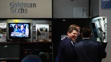 Traders at the Goldman Sachs booth on the floor of the New York Stock Exchange (Chris Hondros/Getty Images)