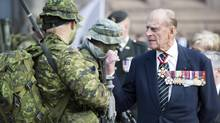 Prince Philip chats with members of the 3rd Battalion of The Royal Canadian Regiment at the Ontario Legislature in Toronto on April 27, 2012. (Frank Gunn/The Canadian Press)