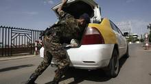 "A policeman checks a car at the entrance of Sanaa International Airport, in Yemen, Wednesday, Aug. 7, 2013. The State Department on Tuesday ordered non-essential personnel at the U.S. Embassy in Yemen to leave the country. The department said in a travel warning that it had ordered the departure of non-emergency U.S. government personnel from Yemen ""due to the continued potential for terrorist attacks"" and said U.S. citizens in Yemen should leave immediately because of an ""extremely high"" security threat level. (Hani Mohammed/AP)"