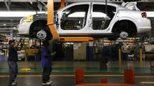 Workers assemble a 2011 Dodge Avenger at the Chrysler Sterling Heights Assembly plant in Sterling Heights, Mich. (Paul Sancya/Paul Sancya/The Associated Press)