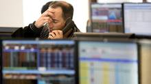 A trader at the Toronto Stock Exchange during a difficult day (CHRIS YOUNG)