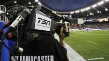 A cameraman from TSN, a sports network in Canada, works as the Montreal Alouettes play the Calgary Stampeders during the CFL's 96th Grey Cup football game in Montreal, November 23, 2008. (SHAUN BEST/REUTERS)