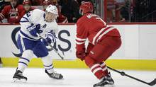 Toronto Maple Leafs' Morgan Rielly takes a shot on goal while Carolina Hurricanes' Ryan Murphy defends in Raleigh, N.C., Saturday, March 11, 2017. (Gerry Broome/AP)