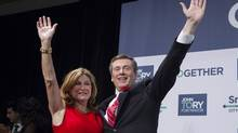Newly elected Mayor John Tory, right, stands with his wife Barbara Hackett as he waves to supporters at a rally after winning the municipal election in Toronto on Monday, October 27, 2014. THE CANADIAN PRESS/Chris Young