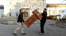 Workmen carry away the Prime Minister's podium November 3, 2015 at Rideau Hall in Ottawa. Prime Minister designate Justin Trudeau and his new cabinet will be sworn-in on November 4. (Dave Chan For The Globe and Mail)