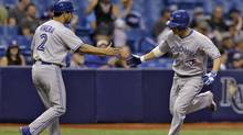 Toronto Blue Jays' Danny Valencia, right, reaches out to shake hands with third base coach Luis Rivera after hitting a home run off Tampa Bay Rays starting pitcher Jeremy Hellickson during the second inning of a baseball game Tuesday, Sept. 2, 2014, in St. Petersburg, Fla. (Chris O'Meara/AP)