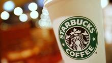 A cup of Starbucks coffee sits on a table in a cafe in central Hong Kong January 16, 2011. (Joel Boh/REUTERS/Joel Boh/REUTERS)