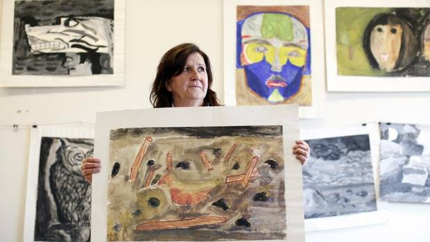 Deb George, a Cowichan elder who serves as the University of Victoria's cultural protocol liaison, holds a painting created by residential-school student Arthur Bolton when he was 10 years old. (CHAD HIPOLITO FOR THE GLOBE AND MAIL)