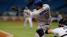 Kendrys Morales of the Toronto Blue Jays hits a double in St. Petersburgh,Fla., against the Tampa Bay Rays on Friday night. (Brian Blanco/Getty Images)