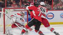 Carolina Hurricanes goalie Cam Ward (30) makes a save in front of Ottawa Senators centre Kyle Turris (7) in the second period at the Canadian Tire Centre in Ottawa on Nov. 26, 2016. (Marc DesRosiers/USA Today Sports)