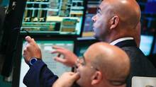 In a Tuesday, July 10, 2012, file photo, traders work at the start of early trading at the New Yorkstock Exchange. U.S. stocks slid for a sixth day Thursday, July 12, 2012, as concern spread that weaker global economic growth and the European debt crisis will hurt U.S. corporate earnings. (Bebeto Matthews/AP Photo)
