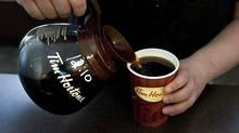 A cup of Tim Hortons coffee is poured in Toronto on May 14 2010. The popular chain is brewing up something new using outlets in Kingston and Sudbury as test markets. Tim Hortons spokesman Nick Javor says the company is introducing a new extra-large cup size which will hold 24 ounces. (Chris Young/The Canadian Press/Chris Young/The Canadian Press)