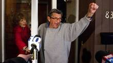 "Penn State coach Joe Paterno and his wife Sue on the front porch of their house, address students. The students yelled ""We Are Penn State"" and Paterno responded, ""Yes we are!"" Penn State University Board of Trustees announced the resignation of president Graham Spanier and firing of football coach Joe Paterno Wednesday Nov. 9, 2011. (JOE HERMITT/AP)"