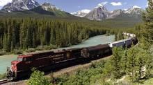 A CP freight train runs along the Bow River and distant Rocky Mountains near Lake Louise, Alta. (LARRY MACDOUGAL/LARRY MacDOUGAL/THE CANADIAN PRESS)