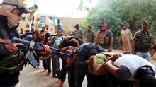 This Saturday, June 14, 2014 file image posted on a militant website which has been verified and is consistent with other AP reporting, appears to show militants from the Islamic State group leading away captured Iraqi soldiers dressed in plain clothes after taking over a base in Tikrit, Iraq. (Uncredited/THE ASSOCIATED PRESS)