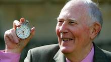 Sir Roger Bannister, who ran the first sub-four-minute mile in 1954, holds the stop watch used by Harold Abrahams to time the race during 50th anniversary celebrations at Pembroke College, Oxford, May 6, 2004. Sir Roger was a 25-year-old medical student when he recorded a time of 3:59.4 for the mile on May 6, 1954. (DAVID BEBBER/REUTERS)