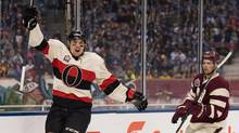 Ottawa Senators' Cody Ceci, left, celebrates after scoring a goal as Vancouver Canucks' Dan Hamhuis looks on during second period NHL action at the Heritage Classic at B.C. Place stadium in Vancouver, B.C., on Sunday March 2, 2014. (JONATHAN HAYWARD/THE CANADIAN PRESS)